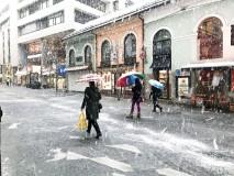 Pripravite dežnike: dež bo marsikje prehajal v sneg, poledica ni izključena
